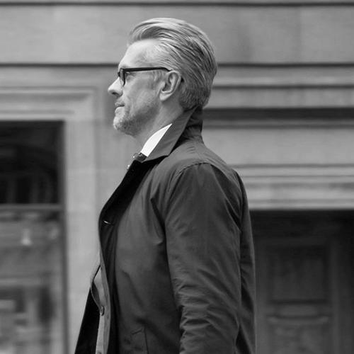 Black and white image of man walking